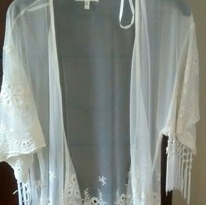 Monteau sheer cover with embroidery and fringe